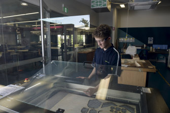 Year 10 student William O'Donnell with the laser-cutting machine at CathWest Innovation College.
