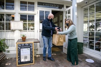 Chef and restaurateur Matt Moran hands Weldon lunch prepared by the team at his Chiswick restaurant.