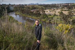 Idyllic spot: New Maribyrnong River advocate Dr Nicole Kowalczyk in Essendon West, with a Melbourne CBD view.
