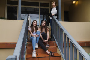 Twins Madelyn (blue jeans) and Lara, with mum Sonia Tecli at their home in Gladesville.