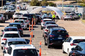 Queues at the drive-through testing clinic at Bondi Beach on Monday.