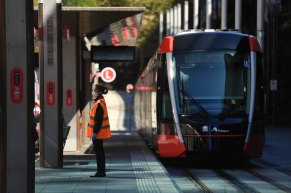 A light rail employee wearing a face mask in Sydney.
