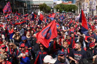 Fans show their strong support for the Demons at 'Footy Place' in Perth.