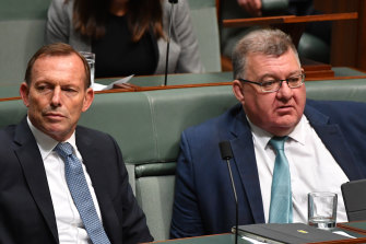 Conservative MP Craig Kelly, right, pictured with former prime minister Tony Abbott, says the emissions reduction fund should not be topped up.
