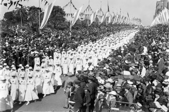 Crowds watching the Voluntary Aid Detachment marching down Park Street at the peace celebrations for the end of  the Great War.