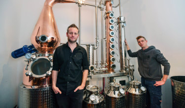 Gin works: Brad Wilson (left) and brother Jarrod with the copper still they've installed for Little Lon Distilling Co at historic 17 Casselden Place.