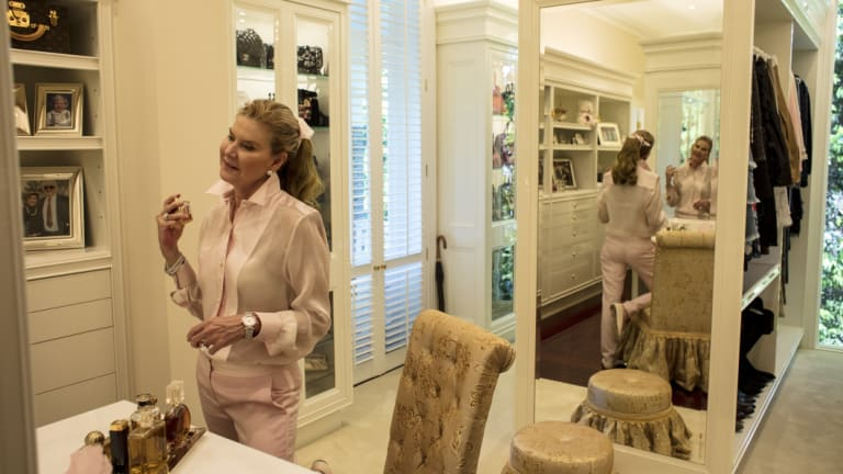 Craig-Lee in a corner of her dressing room, with two of the handbag display cases in the background.