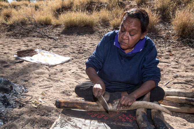 Barbara Shaw cooks kangaroo tails at Honeymoon Gap near Alice Springs.