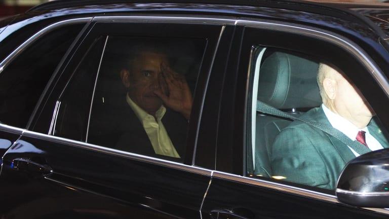 Barack Obama is seen inside a motorcade in Sydney.