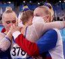 Team ROC celebrates their gold medal win during the women's team gymnastics final.
