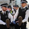 Police arrest climate change protesters in London.