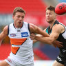 Giants overpowered as late rally keeps Port Adelaide top of AFL ladder