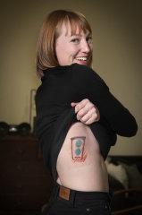 Harriet Noall, 25, with her fresh tattoo.