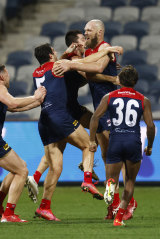 The Demons erupt after Max Gawn's minor premiership-winning goal against Geelong.