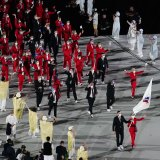 Athletes march under the Russian Olympic Committee flag at Friday's opening ceremony.