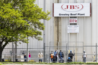 Employees exit from the JBS Beef Production Facility in Greeley, Colorado.