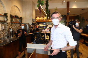 NSW Premier Dominic Perrottet visits a cafe at Casula Mall on Thursday.