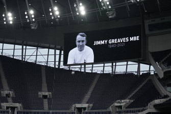 A video screen shows an image of former player Jimmy Greaves before the English Premier League match between Tottenham and Chelsea.