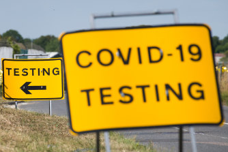 A traffic sign directs people towards the temporary testing centre on the site at Manston Airport in England.