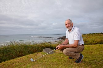 Rex Grady near the barrier erected by the Port Fairy golf club to protect the course from rising seas.