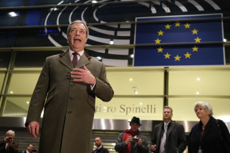 Nigel Farage speaks to the media as he departs following a historic vote for the Brexit agreement at a session of the European Parliament on January 29.