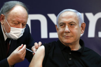 Israeli Prime Minister Benjamin Netanyahu receives a coronavirus vaccine at Sheba Medical Centre in Ramat Gan, Israel  in December.