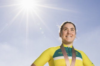 Canberra cyclist Chloe Hosking, pictured here after winning a Commonwealth Games gold medal,  said she takes care to avoid training in the middle of the day.
