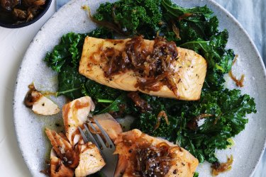 Salmon fillets with caramelised onion and wilted greens.