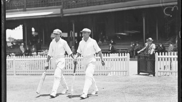 Don Bradman and Sid Barnes going out to bat in 1930. Prime Minister John Howard in 2000 moved to protect Bradman's name from commercial misuse.