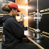 The new champion couldn't resist taking her own photo of the trophy in the locker room after her emphatic win.
