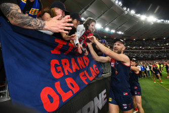 Demons captain Max Gawn celebrates with the Melbourne faithful after the grand final win in Perth.