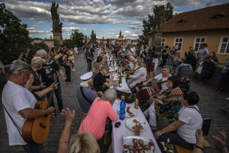 Prague residents dine on a 500-metre long table set on the Charles Bridge in June.