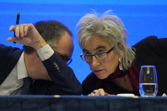 Marion Koopmans, right, and Peter Ben Embarek of a World Health Organisation team chat to each other during the joint press conference in Wuhan.