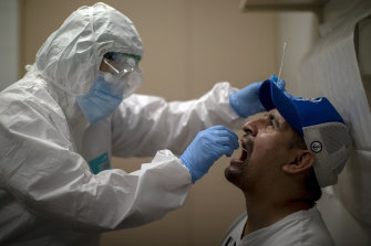 A man is tested for coronavirus in Barcelona, Spain.