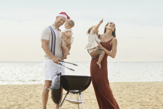 """Kris wears M.J. Bale top and Polo Ralph Lauren shorts, from Myer. Sarah wears Scanlan & Theodore bodysuit and skirt. Weber """"Compact Kettle"""" charcoal barbecue. Mila and Frankie wear Country Road."""