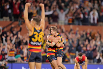 Crows players celebrate after the final siren.