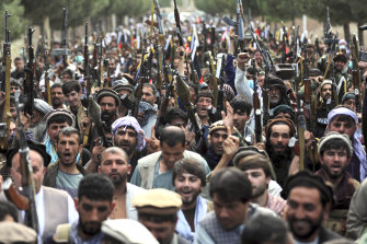 Afghan militiamen join defence and security forces in Kabul during a gathering  to mobilise local militias across the country.