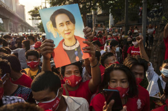 Pro-democracy protesters hold an image of Aung San Suu Kyi during a protest outside Myanmar's embassy in Bangkok on Monday.