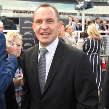 Winning streak: Chris Waller enjoys the spoils of victory.