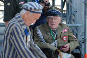 A Polish military veteran and a concentration camp survivor attend an international ceremony in Warsaw on Sunday to commemorate the 80th anniversary of the outbreak of World War II.