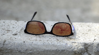 Sunglasses covered in blood are left at the site of a suicide attack in Kabul targeting Afghanistan's minority Hazaras.