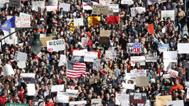 Students march during a walkout to protest against gun violence in Madison, Wisconsin.
