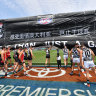 St Kilda and Port Adelaide players run through the banner before the match in Shanghai in 2019.