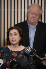 'More to do': Environment Minister Lily D'Ambrosio and Rob Millard of the government's Metropolitan Waste and Resource Recovery Group face the media in July.