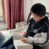 Seven-year-old Dennis Liu from Melbourne is stuck in Wuhan.