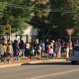 Dozens of parents wait for students outside Kent Road Public School on Wednesday afternoon.