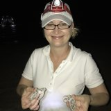 Anna Marsden, managing director of Great Barrier Reef Foundation with green turtle hatchlings.