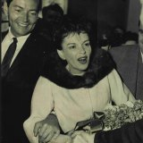 Judy Garland arrives at Sydney Airport with Mark Herron in 1964.