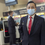 Qantas Cabin Manager Andrew Goh says he is proud to be flying home Australians who have been stranded in the UK.
