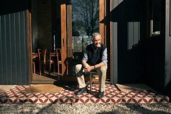 Retired stockbroker Nicholas Wright sits outside his Dorrigo home.